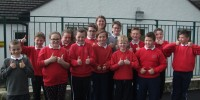 Mrs Jo Thompson, Principal of Loughries PS with pupils celebrating the M...