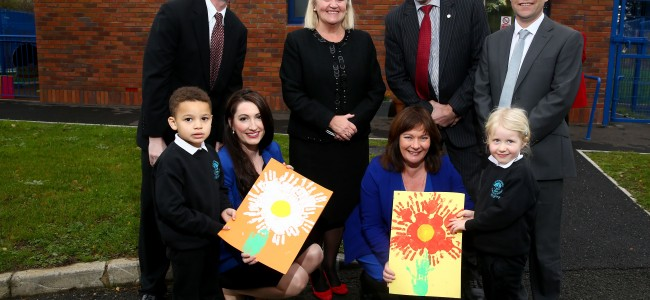 Press Eye - Belfast -  Northern Ireland - 23rd November 2015 - Photo by William Cherry  Cranmore Integrated Primary School pupils Joshua and Poppy presented Junior Ministers Emma Pengelly and Jennifer McCann with hand-painted cards to celebrate the official opening of the school's new pre-school facilities. Also pictured are (l-r) Daniel Lawton, US Consul General, Mrs Helen Hamilton, Chair Board of Governors,  Trevor Ringland MBE and Mr William Doherty, Principal. The 24 pupils are now enjoying a larger playroom, quiet room, welcoming reception area & improved storage and toilet facilities, boosting the school's youngest childrens' opportunities to play and learn together.  The £220,000 project was funded by Kevin Curley, American Ireland Fund,  with match-funding raised by the school‎ (£100,000 each), and £20,000 from the Integrated Education Fund.
