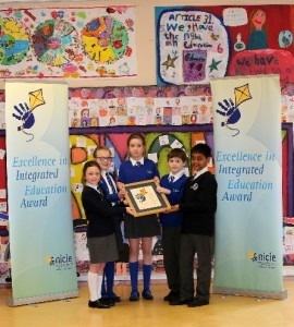 Glencraig CIPS pupils celebrating receiving the Excellence in Integrated Education Award in 2016 .